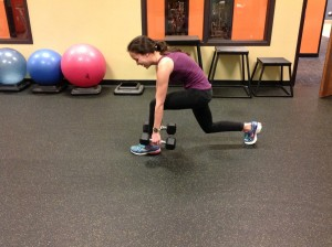In this picture lauren is reaching her shoes, decreasing back muscle activation and facilitating glute activation.